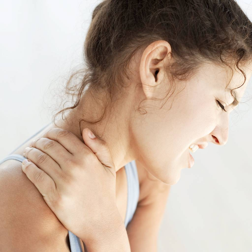 Woman feels severe neck pain